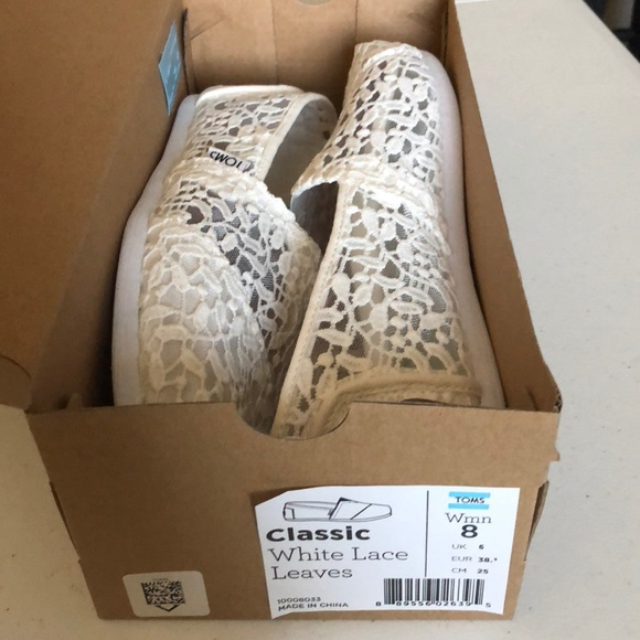 0425a2acc89 TOMS Classic White Lace Leaves Slip Ons